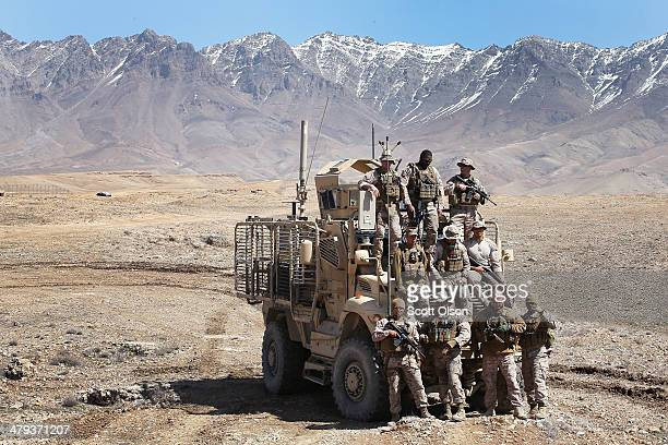 S Navy Seabees from Naval Mobile Construction Battalion 28 pose for a picture with an MRAP at an overwatch position they established to provide...