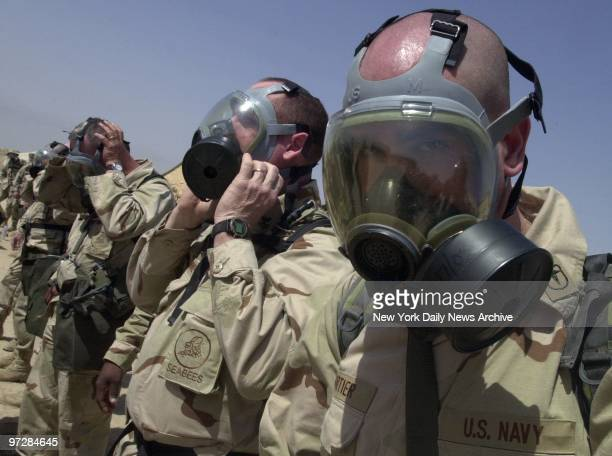 Navy Seabees go through a gas mask drill at Al Jaber Air Base in Kuwait American troops and equipment are massed in Kuwait in readiness for a...