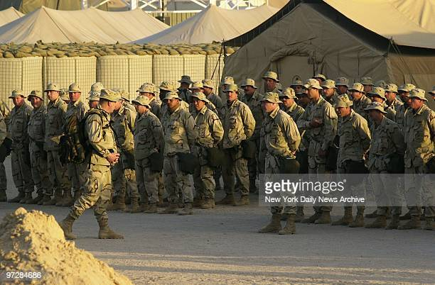 Navy Seabees line up for inspection at the Al Jaber Air Base in Kuwait American troops and equipment are massed in Kuwait in readiness for a possible...
