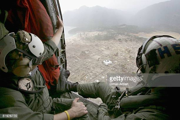 Navy Seahawk helicopter crew from carrier USS Abraham Lincoln observe the devastation caused by the Indian Ocean tsunami on January 8 Aceh Indonesia...