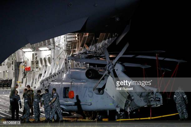 Navy Seahawk helicopter is offloaded from a RAAF C17 Globemaster aircraft at the RAAF base in Bullsbrook on March 28 2014 in Perth Australia The...