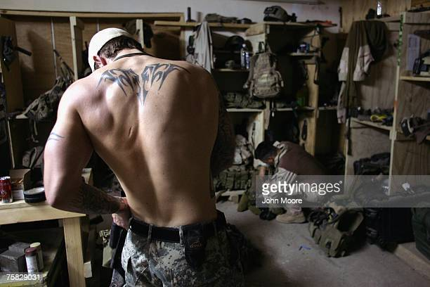 S Navy SEAL prepares for a night mission to capture Iraqi insurgent leaders July 27 2007 near Fallujah Iraq American Special Forces operate...