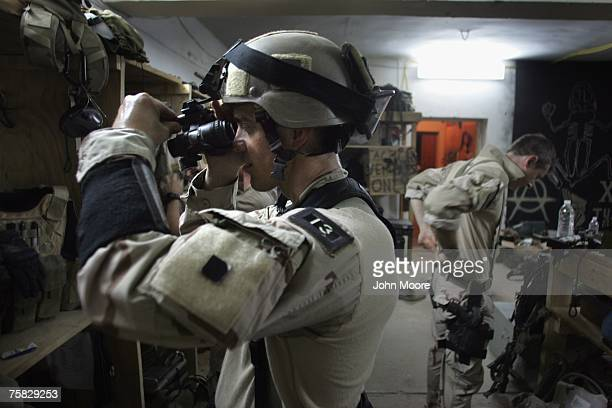 S Navy SEAL prepares his night vision goggles for a mission to capture Iraqi insurgent leaders July 27 2007 near Fallujah Iraq American Special...