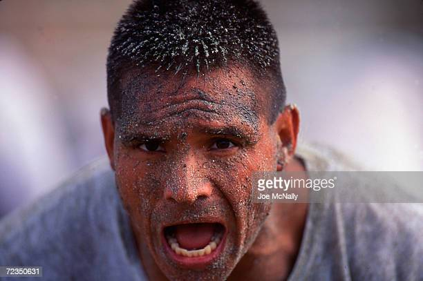 Navy Seal trainee pumps himself up before the day's trials in this undated photo taken in 2000 at the Coronado Naval Amphibious Base in San Diego...