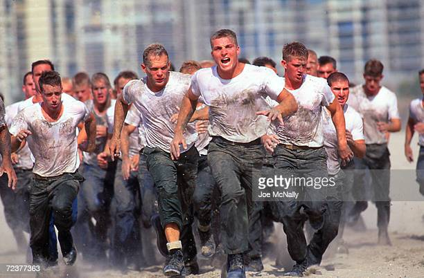 Navy Seal trainees rush the beach under orders in this undated photo taken in 2000 at the Coronado Naval Amphibious Base in San Diego, California....