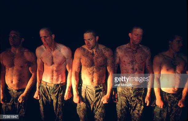 Navy Seal trainees shiver on the beach after going in the dark frigid waters of the Pacific in this undated photo taken in 2000 at the Coronado Naval...