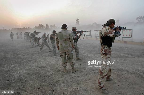 S Navy SEAL watches Iraqi army scouts during weapons training July 26 2007 in Fallujah Iraq The SEALS are training Iraqi forces on advanced combat...