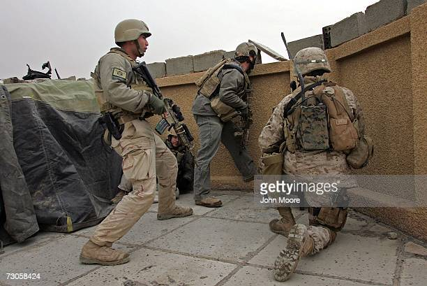 S Navy Seals and Marines look out from an observation post towards insurgents January 21 2007 in Ramadi in the Anbar province of Iraq With daily...