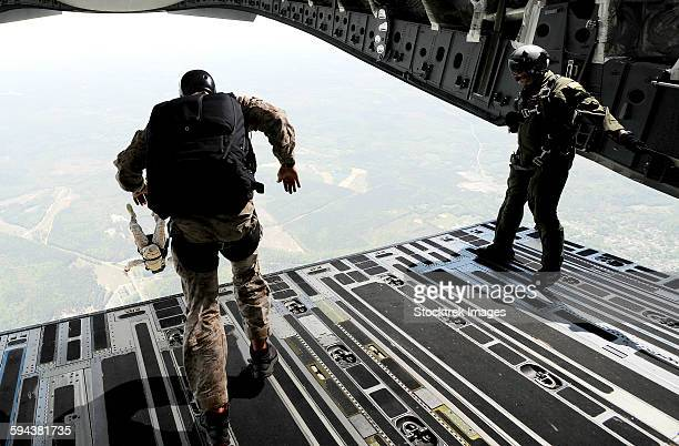 Navy SEALs jump from the ramp of a C-17 Globemaster III over Virginia.