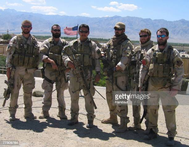 Navy SEALs operating in Afghanistan in support of Operation Enduring Freedom Sonar Technician 2nd Class Matthew G Axelson of Cupertino California...