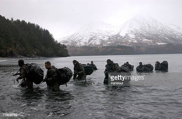 Navy SEALs perform Advanced Cold Weather training to experience the physical stress of the environment and how their equipment will operate or even...