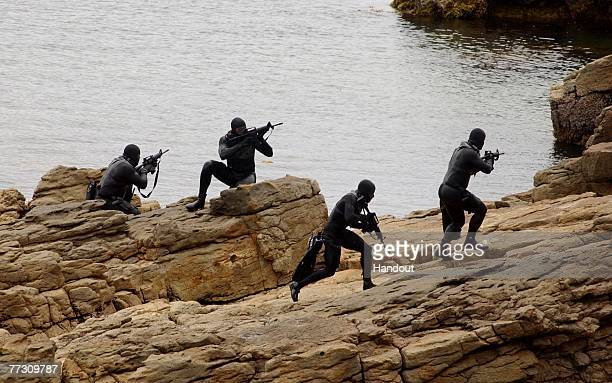 Navy SEALs practice Over The Beach evolutions during a training exercise May 25 2004 in a Remote Training Facility SEALs are known for their ability...