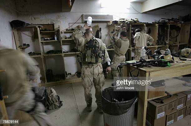 S Navy SEALS prepare for a night mission to capture Iraqi insurgent leaders July 27 2007 near Fallujah Iraq American Special Forces operate...