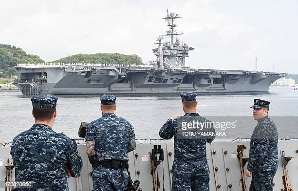 Navy servicemen see off the nuclear-powered aircraft carrier USS George Washington as it leaves the US naval base in Yokosuka, 60 kms south of Tokyo,...