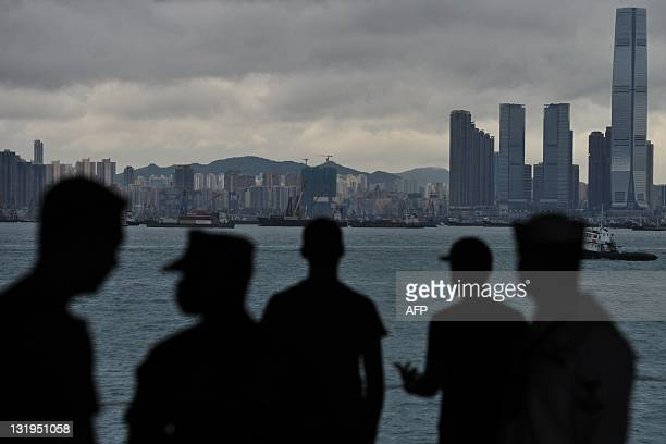 US navy servicemen stand onboard the USS George Washington a nuclear powered aircraft carrier in Hong Kong on November 9 2011 The Nimitz Class...