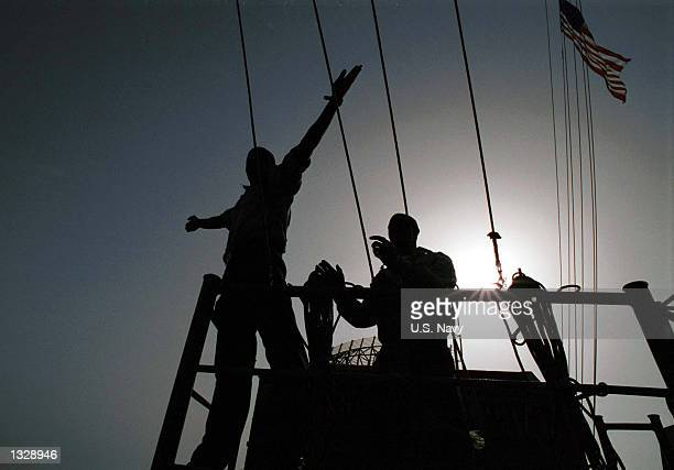 Navy Signalmen pass phonetic signals to the fast combat support ship USS Sacramento October 12, 2001 on board the aircraft carrier USS Carl Vinson....
