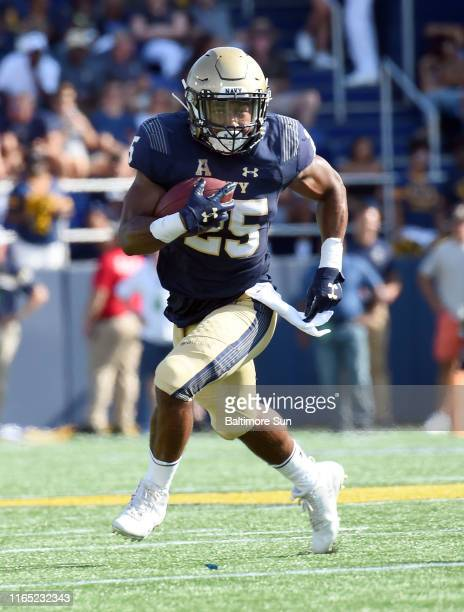 Navy slotback Tazh Maloy runs for big yards in the second quarter against Holy Cross on Saturday, Aug. 31 at Navy-Marine Corps Memorial Stadium in...
