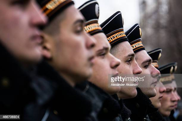 Navy soldiers prepare to march as people celebrate the first anniversary of the signing of the decree on the annexation of the Crimea by the Russian...