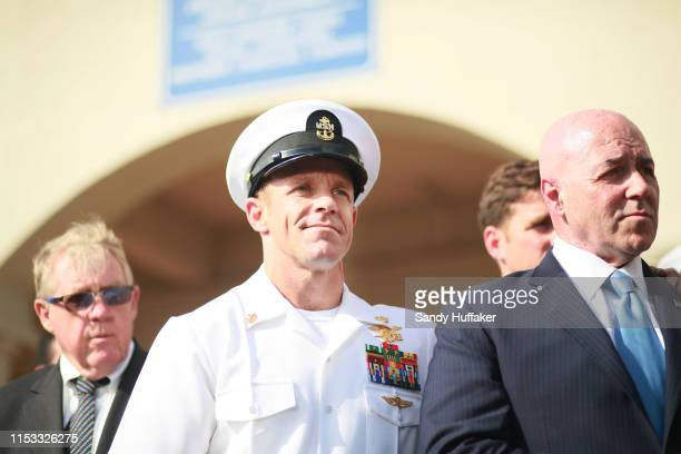 R Navy Special Operations Chief Edward Gallagher celebrates after being acquitted of premeditated murder at Naval Base San Diego July 2 2019 in San...