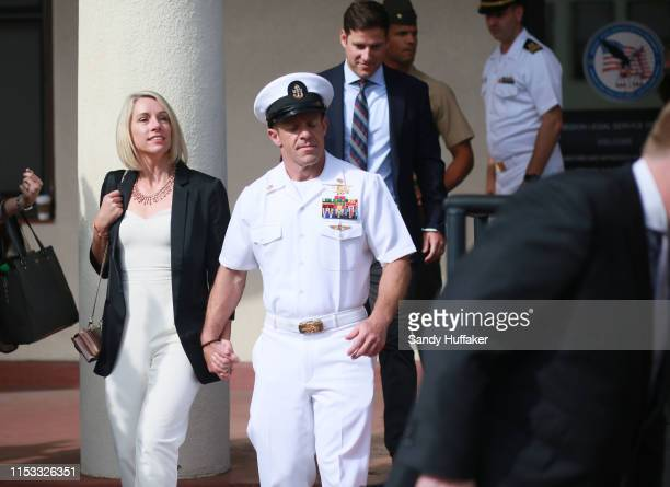 R Navy Special Operations Chief Edward Gallagher celebrates with his wife Andrea after being acquitted of premeditated murder at Naval Base San Diego...
