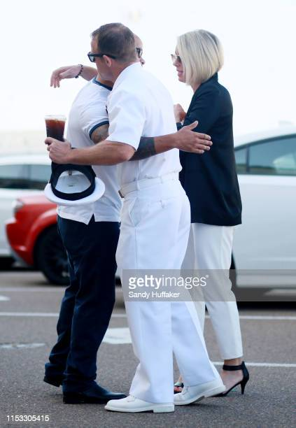 Navy Special Operations Chief Edward Gallagher hugs a supporter before walking into military court with his wife Andrea Gallagher on July 2 2019 in...