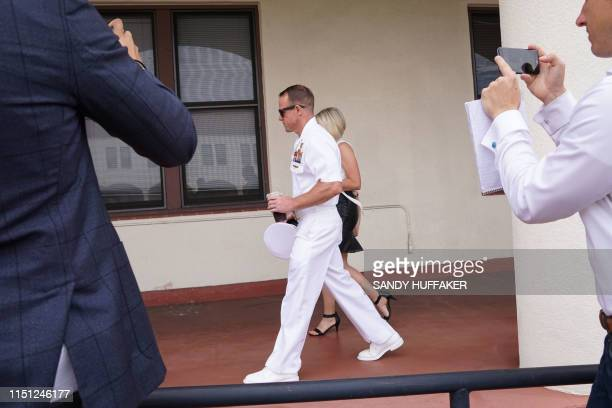 Navy Special Operations Chief Edward Gallagher walks into military court with his wife Andrea Gallagher on June 21 2019 in San Diego California First...