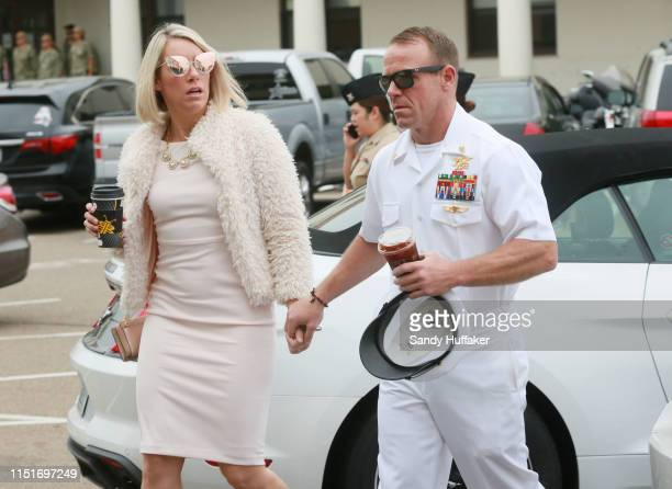Navy Special Operations Chief Edward Gallagher walks into military court with his wife Andrea Gallagher June 24 2019 in San Diego California Chief...
