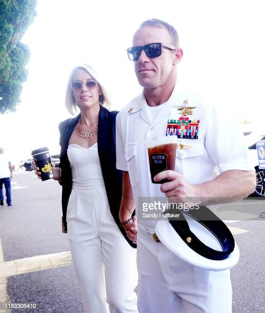 Navy Special Operations Chief Edward Gallagher walks into military court with his wife Andrea Gallagher on July 2 2019 in San Diego California Jury...
