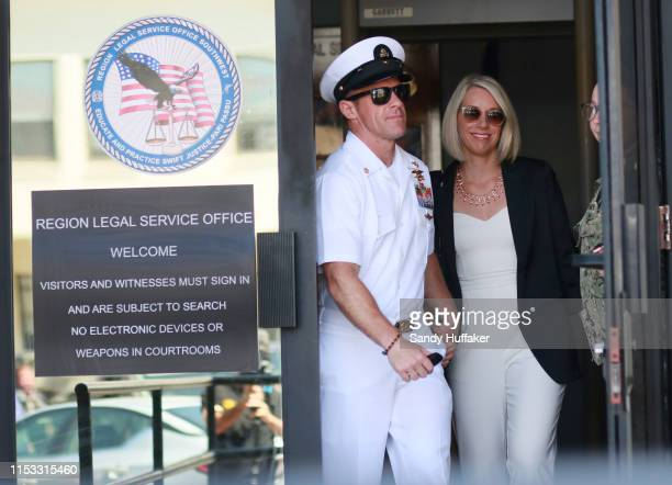 Navy Special Operations Chief Edward Gallagher walks out of military court with his wife Andrea Gallagher during lunch recess on July 2 2019 in San...