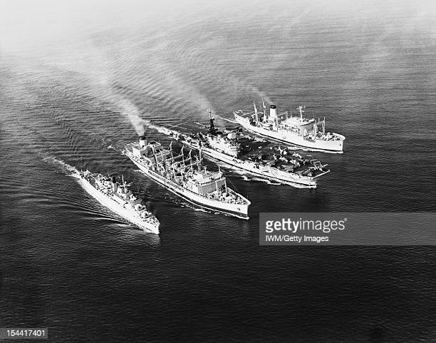 Navy 'supermarket' Delivers The Goods At Sea January 1968 Aerial Photograph Arabian Sea Two of the Royal Navy's modern supply ships delivering fuel...