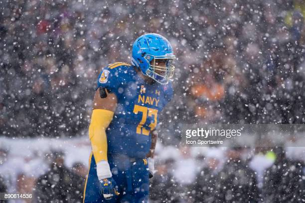 Navy Tackle Michael Raiford looks on between plays in the first half during the game between The Army Black Knights and Navy Midshipmen on December...