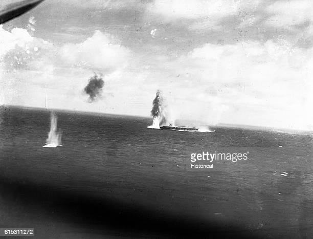 Navy torpedo and dive bombing planes attack a Japanese Shokako classcarrier on the morning of May 8 during the Battle of the Coral Sea The carrier...