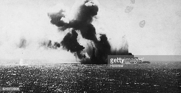 Navy torpedo planes attack the Japanese Aircraft CarrierShoho during the battle of the Coral Sea Two Navy torpedo planes circle the carrier One is...
