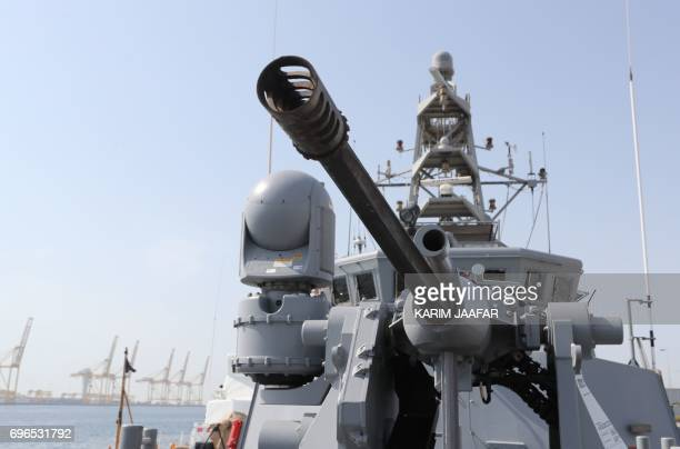 A navy vessel is seen during a joint military exercise between Qatar and the US navy in Doha on June 16 2017 The United States agreed a $12billion...