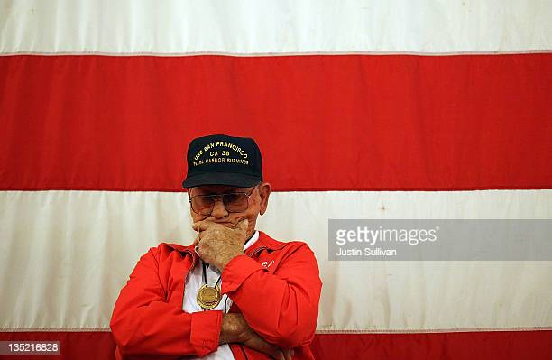 Navy veteran and Pearl Harbor survivor Ed Silveira looks on during a Pearl Harbor rememberance service aboard the USS Hornet on December 7 2011 in...