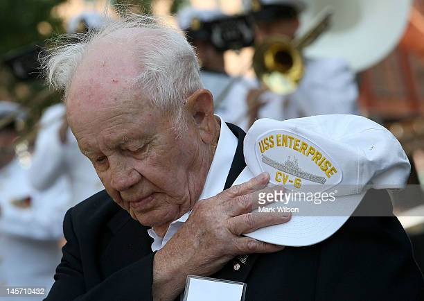 S Navy veteran Howard Snell bows his head during a ceremony and commemoration of the 70th anniversary of the Battle of Midway at the US Navy Memorial...