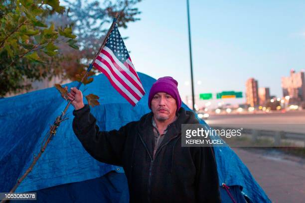 Navy veteran Jim is among the more than 200 people who live at the large encampment along Hiawatha and Cedar Avenues in Minneapolis Minnesota on...