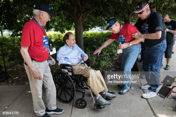 Navy veteran Leon Brooks of Nevada second from right got out of his wheelchair to greet former Senator Bob Dole RKansas while Air Force veteran James...