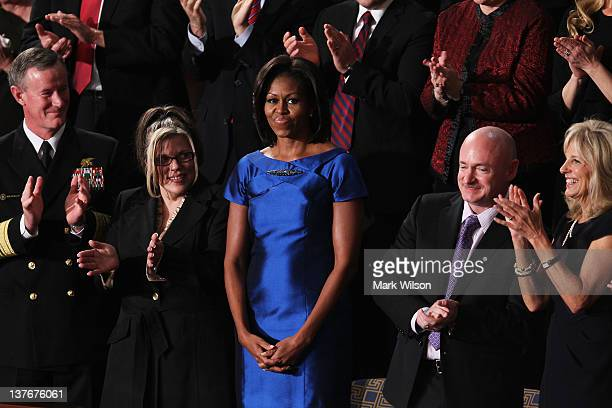 US Navy Vice Admiral William McRaven Process Operator at the Siemens Charlotte Energy Hub Jackie Bray First Lady Michelle Obama Mark Kelly former...