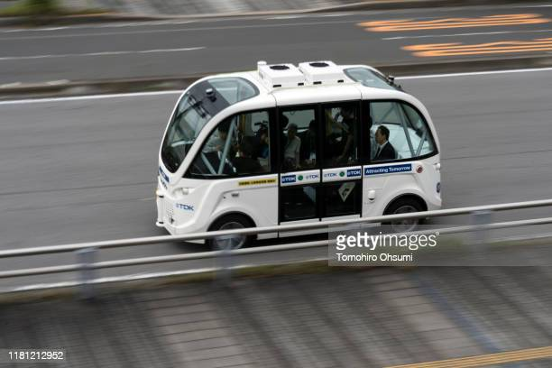 Navya autonomous electric shuttle bus operated by SB Drive Corp a unit of SoftBank Group Corp is test driven on a public road during the Ceatec Japan...