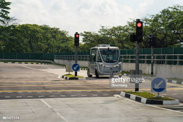 A Navya SAS autonomous electric passenger bus waits at a signal light while travelling along the test circuit at the Centre of Excellence for Testing...