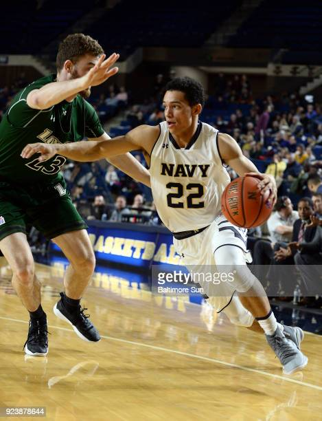 Navy's Cam Davis drives against Loyola's Brent Holcombe in the first half on Saturday Feb 24 at Alumni Hall in Annapolis Md Navy won 6256