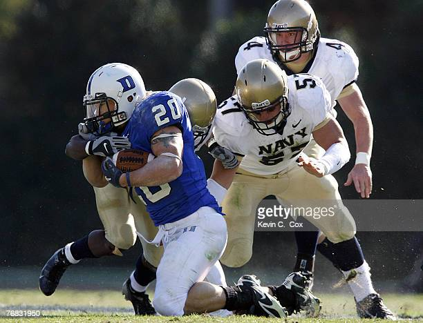 Navy's cornerback Jeremy McGown linebacker Rob Caldwell and linebacker Clint Sovie tackle Duke running back Justin Boyle during the first half...