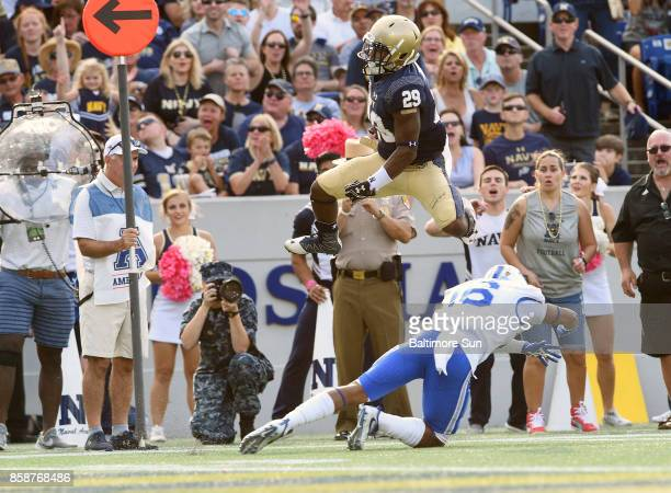 Navy's Darryl Bonner leaps Air Force defender Robert Bullard and lands in the end zone on a 10yard touchdown run in the second quarterat NavyMarine...