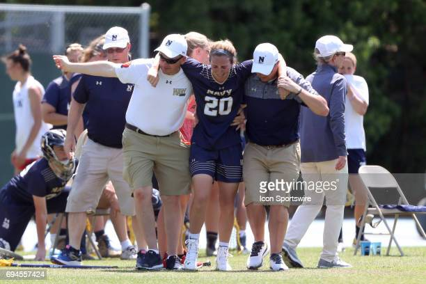 Navy's Meghan Hubley is helped off of the field after suffering a gameending injury The University of North Carolina Tar Heels hosted the US Naval...
