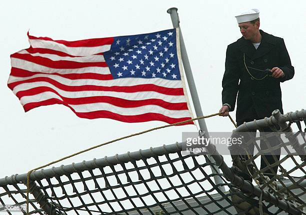 Navy's soldier checks up a rope on the command ship Blue Ridge of the US Navy's Seventh Fleet in Shanghai, 24 February 2004. The command ship of the...