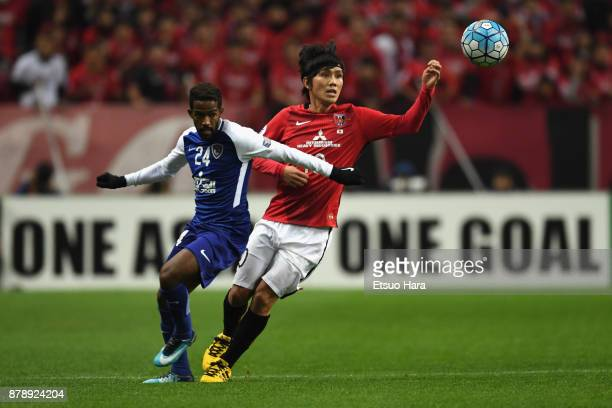 Nawaf Al Abid of AlHilal and Yosuke Kashiwagi of Urawa Red Diamonds compete for the ball during the AFC Champions League Final second leg match...