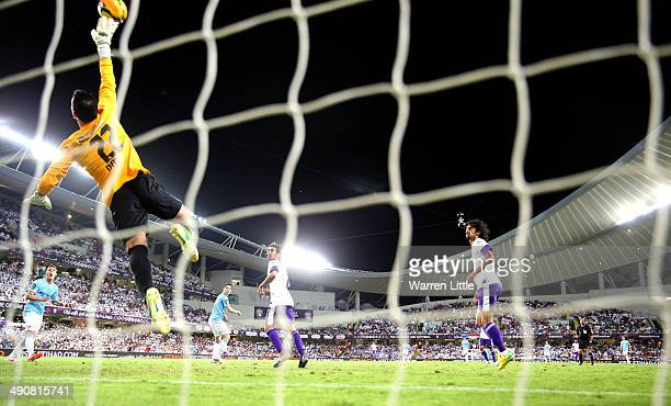 Nawaf Al Khaldi of Al Ain saves a shot on goal during the friendly match between Al Ain and Manchester City at Hazza bin Zayed Stadium on May 15,...