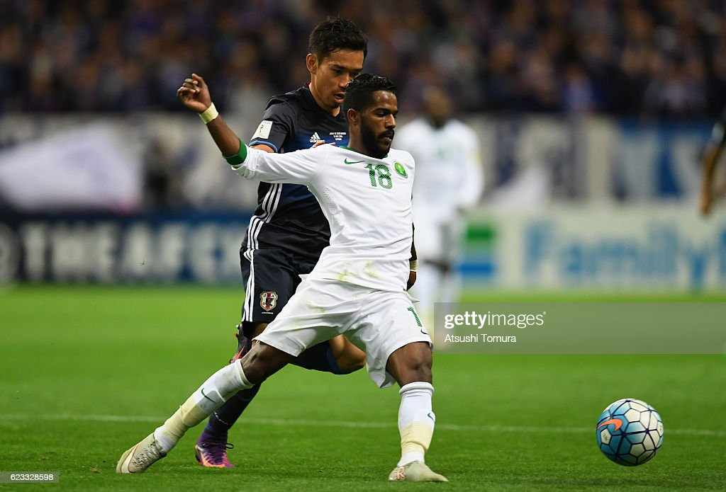 Nawaf Alabid of Saudi Arabia and Yuto Nagatomo of Japan compete for the ball during the 2018 FIFA World Cup Qualifier match between Japan and Saudi Arabia at Saitama Stadium on November 15, 2016 in Saitama, Japan.