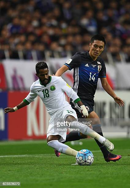 Nawaf Alabid of Saudi Arabia and Yuya Kubo of Japan compete for the ball during the 2018 FIFA World Cup Qualifier match between Japan and Saudi...